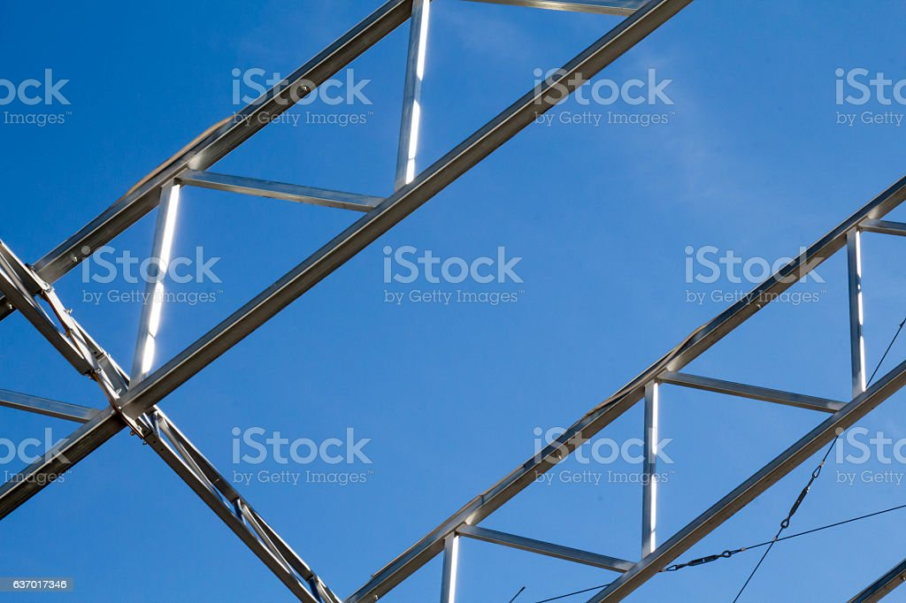 Slanted metal trusses with triangular pattern stock photo