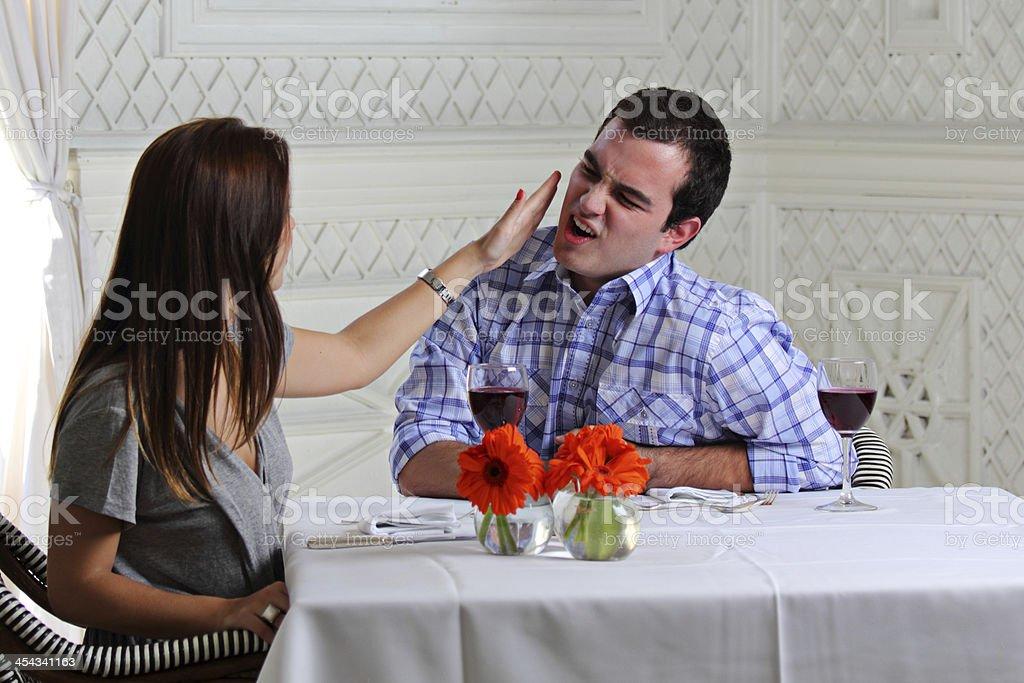 Slap on his face stock photo