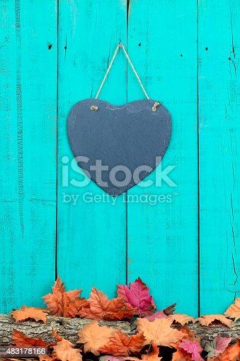 istock Slate heart with fall foliage border 483178166