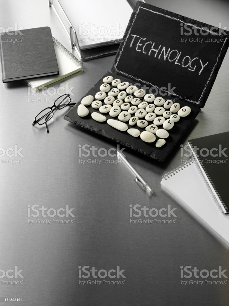 Slate Laptop Computer with Technology in a Modern Office royalty-free stock photo