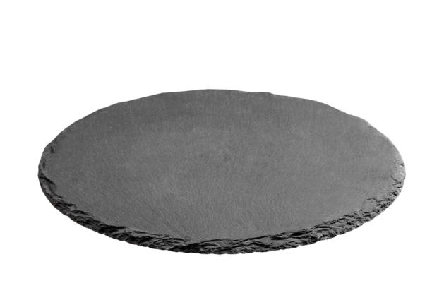 Slate plate on table. black slate stone isolated on white background. copy space stock photo