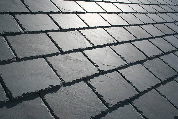slate roof with sun glare - leisteen stockfoto's en -beelden