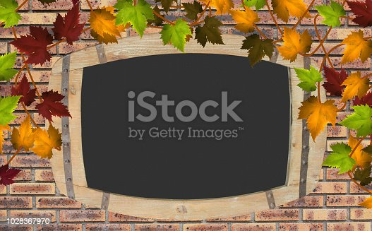 Slate wooden frame hanging on a brick wall  A Virginia creeper hanging on a brick wall  Text space