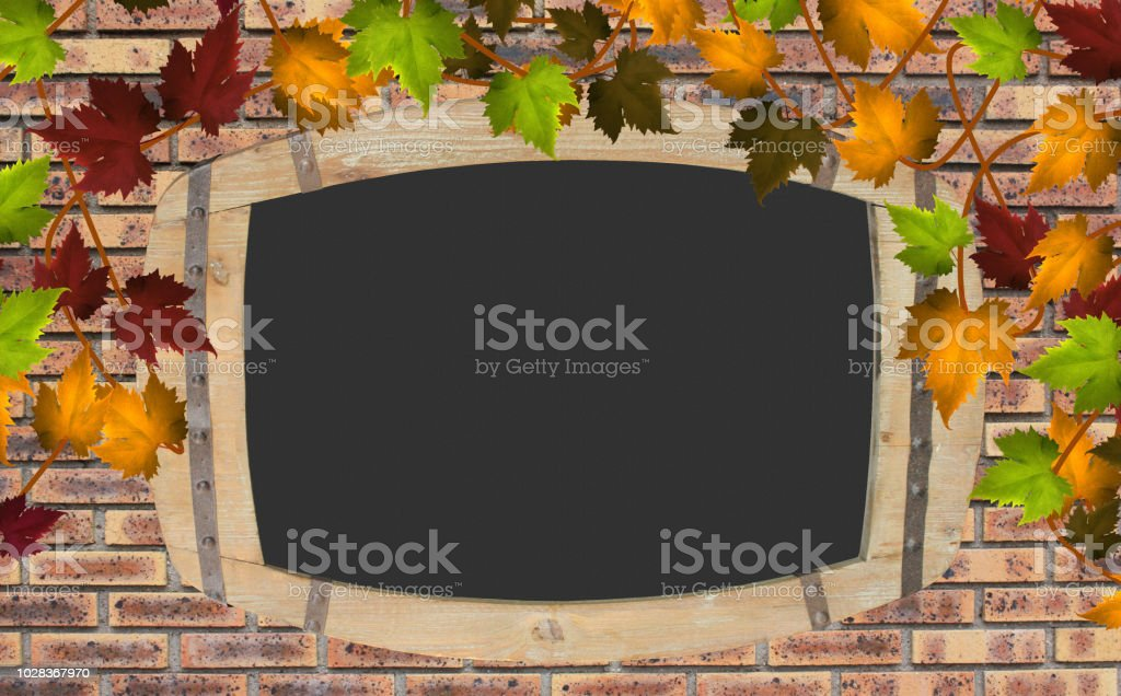 Slate wooden frame hanging on a brick wall   Text space stock photo