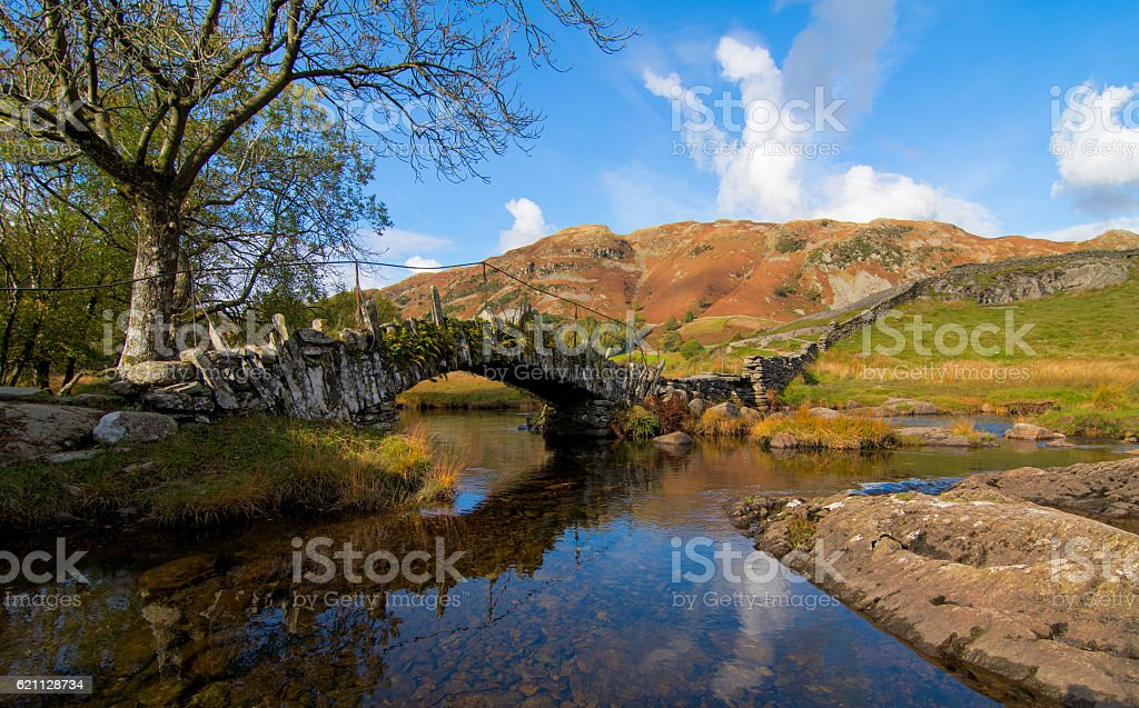 Slaters Bridge, Little Langdale, Lake District Slaters Bridge is a old foodbridge near Little Langdale in the Lake District, UK. Ancient Stock Photo