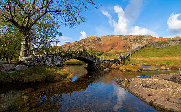 Slaters Bridge, Little Langdale, Lake District Slaters Bridge is a old foodbridge near Little Langdale in the Lake District, UK. cumbria stock pictures, royalty-free photos & images