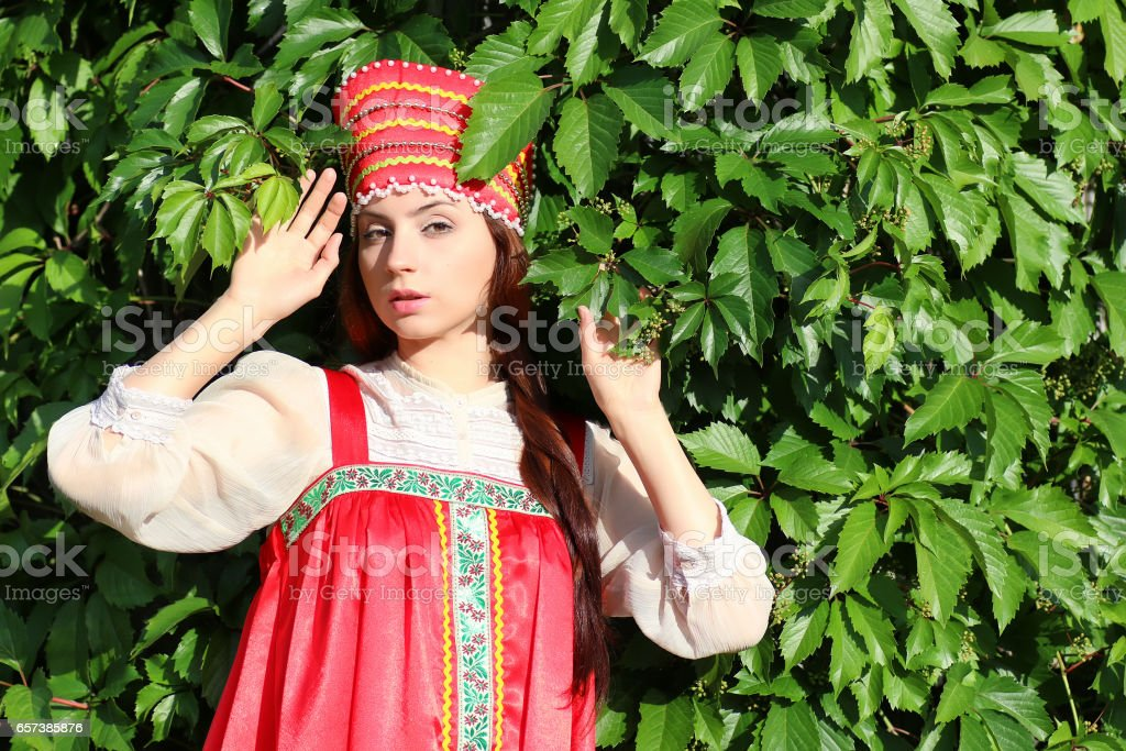 Slav in traditional dress ivy wall tree stock photo