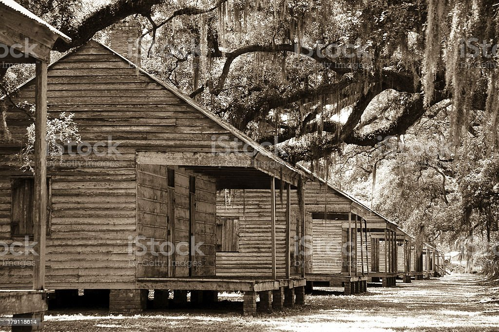 Slave Row in Sephia Nostalgic shot of a row of slave cabins at a Southern Louisiana plantation Antebellum Stock Photo