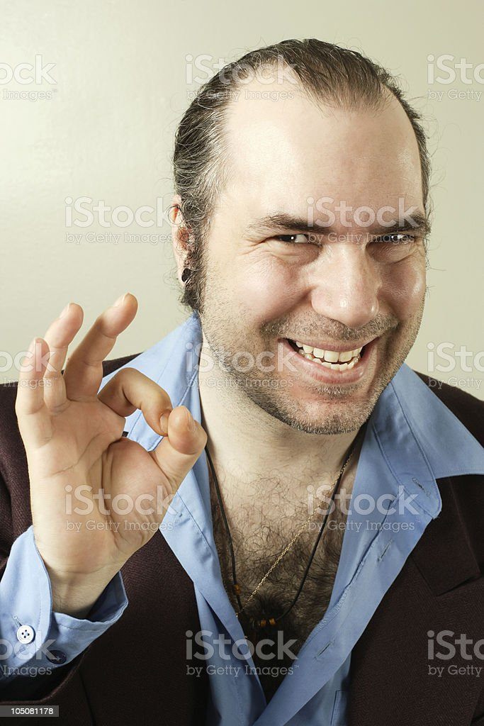 Sleazy smiling con man stock photo