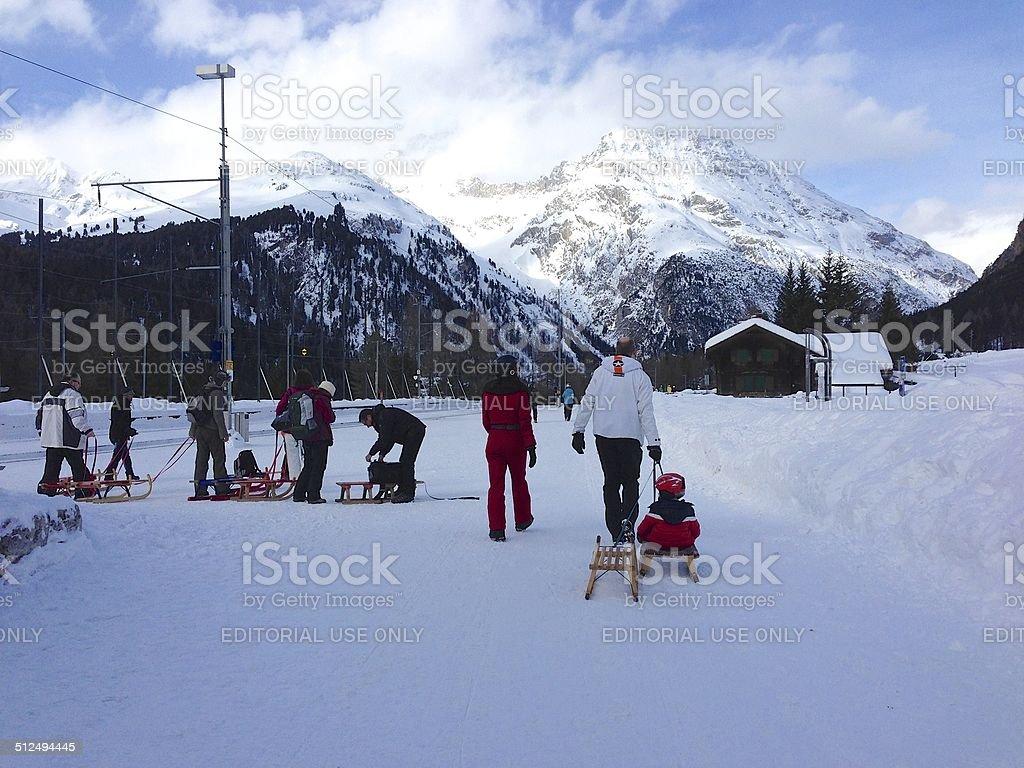 Sledders heading from Preda to Bergün, Switzerland stock photo
