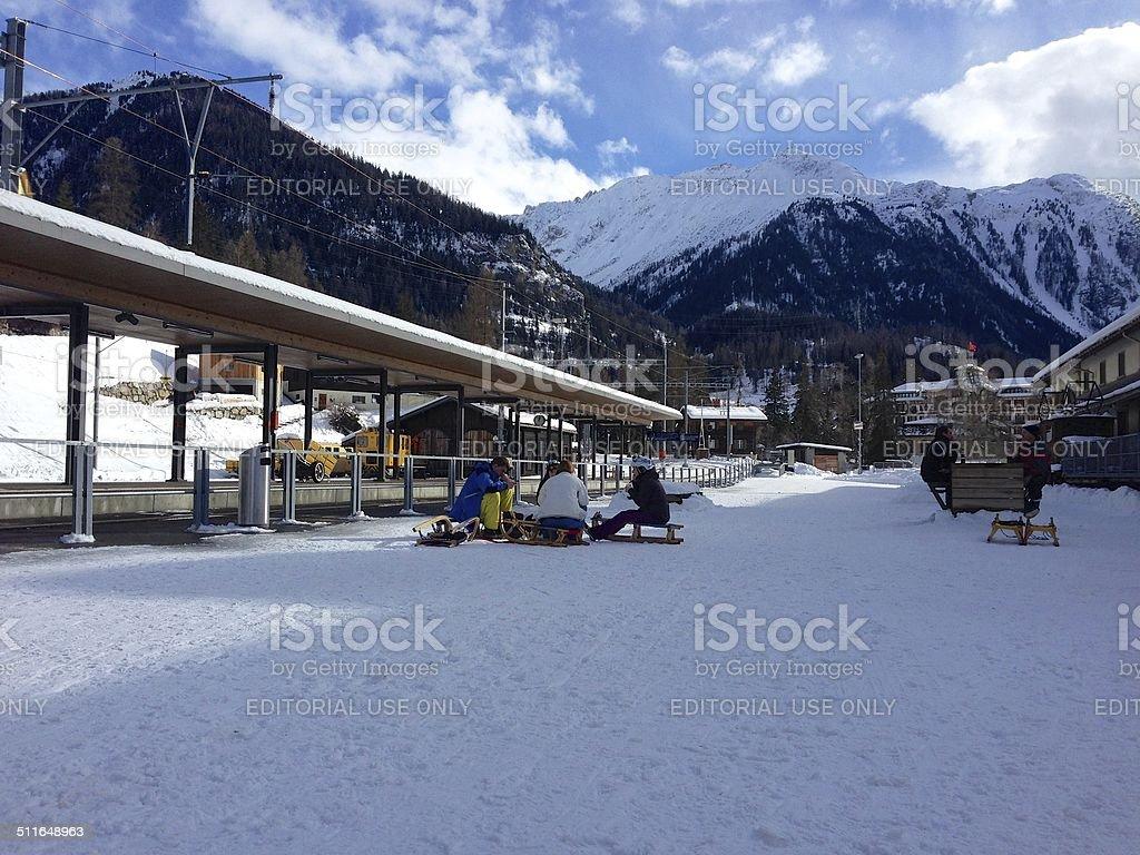 Sledders wait for the train in Bergün, Switzerland stock photo