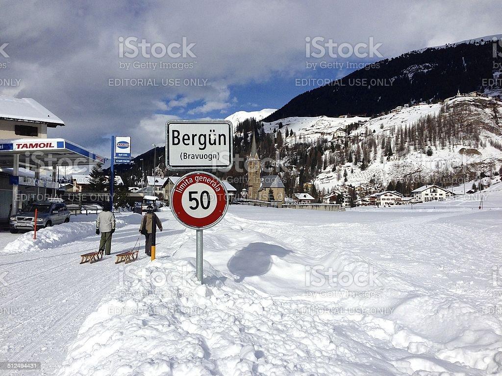 Sledders walking into Bergün, Switzerland stock photo
