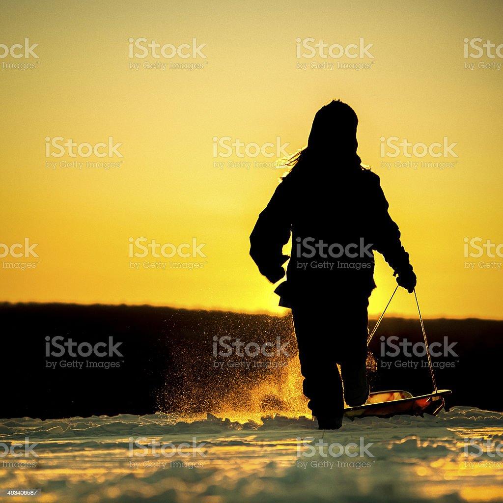 Sledding into the sunset royalty-free stock photo