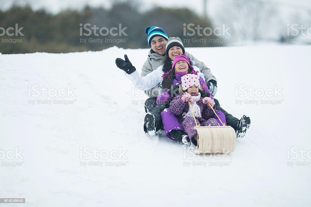 Sledding on a Snow Day stock photo