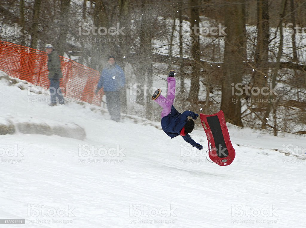 sledding wipe out royalty-free stock photo