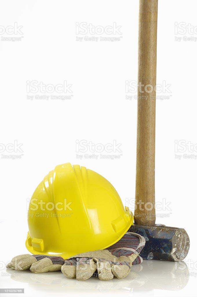 Sledgehammer, hard hat, gloves royalty-free stock photo