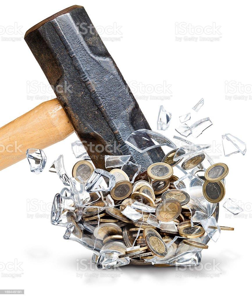 Sledgehammer Smashing Open a Euro Coin Filled Piggy Bank stock photo