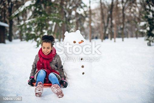 Young girl enjoying in winter games