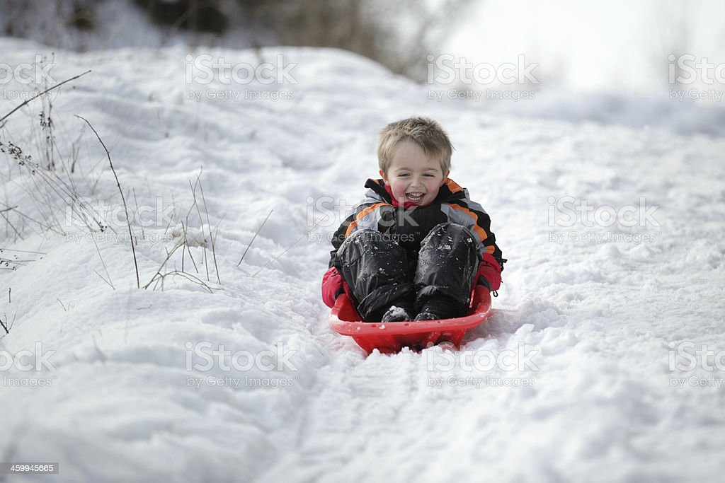 Sledging in the snow stock photo