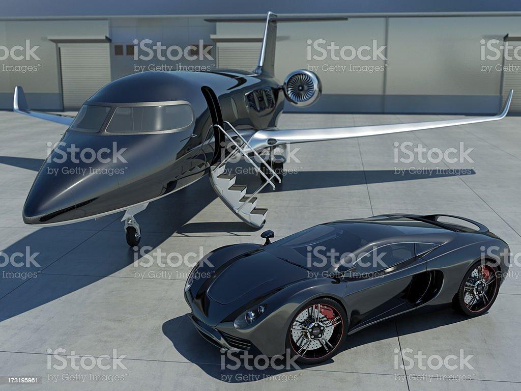 Sleek black sports car and black corporate jet stock photo