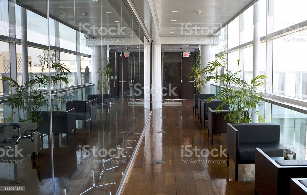 Sleek mirrored office space, with large windows & wood floor royalty-free stock photo
