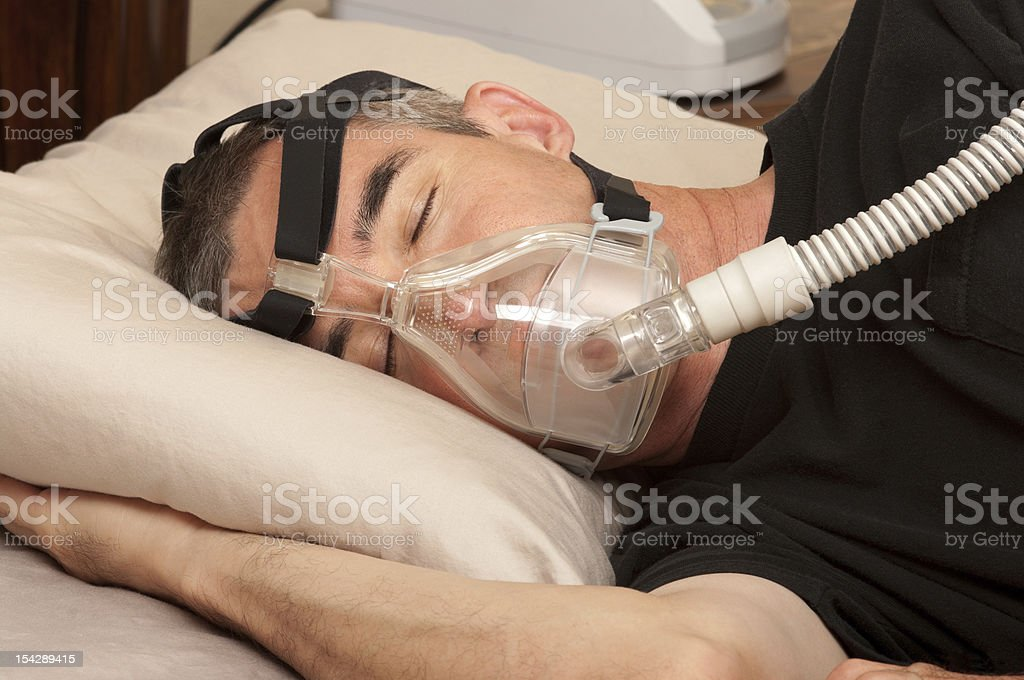 Sleep Apnea and CPAP - Royalty-free Adult Stock Photo