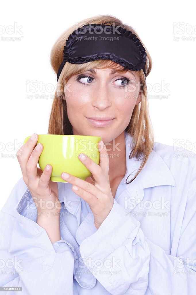 sleep mask wearing female on morning with cup royalty-free stock photo