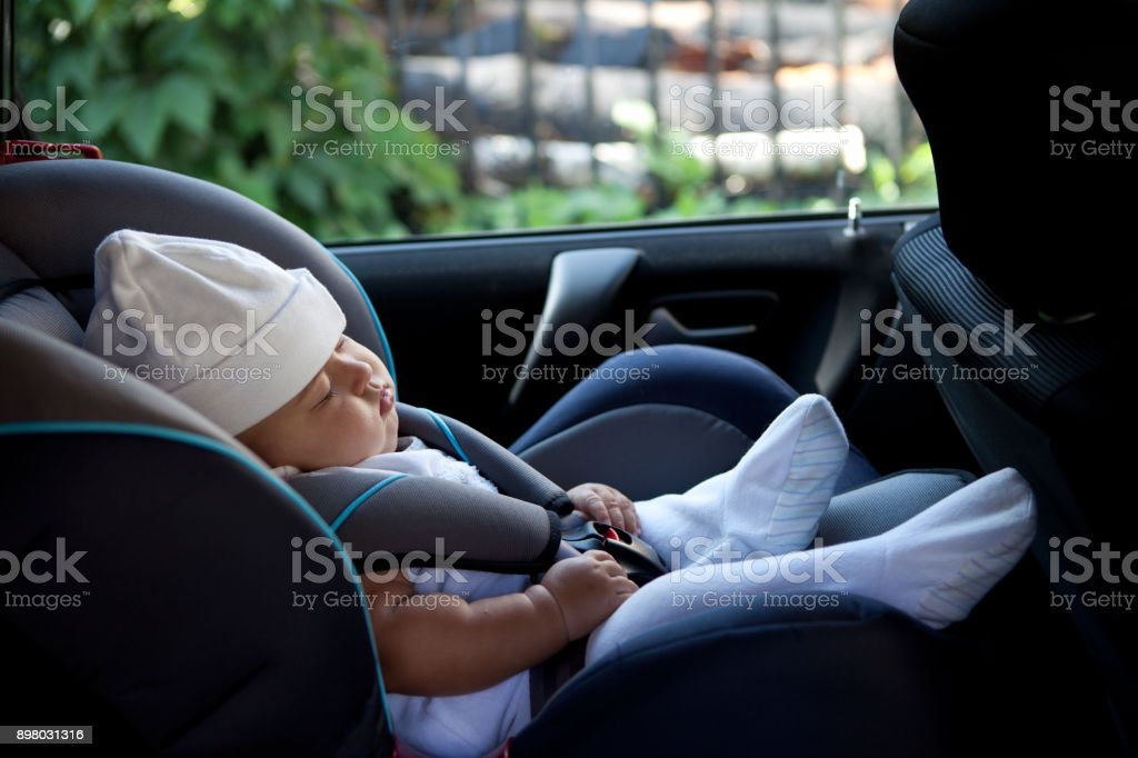 Sleep of the child in the car stock photo