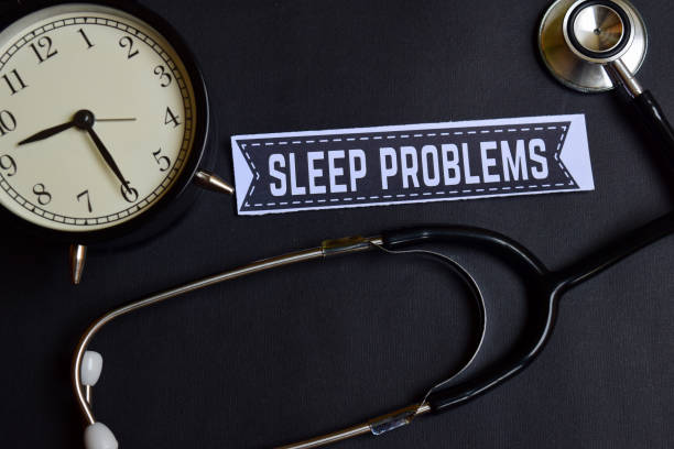 Sleep Problems on the paper with Healthcare Concept Inspiration. alarm clock, Black stethoscope. stock photo