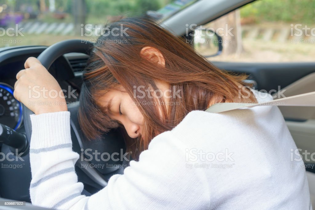 Sleep, tired, close eyes young woman driving her car after long hour trip, Sleep deprivation, accident concept. stock photo