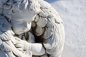 istock Sleeping angel statue.Angel guardian sleeping in white snow background 946791960