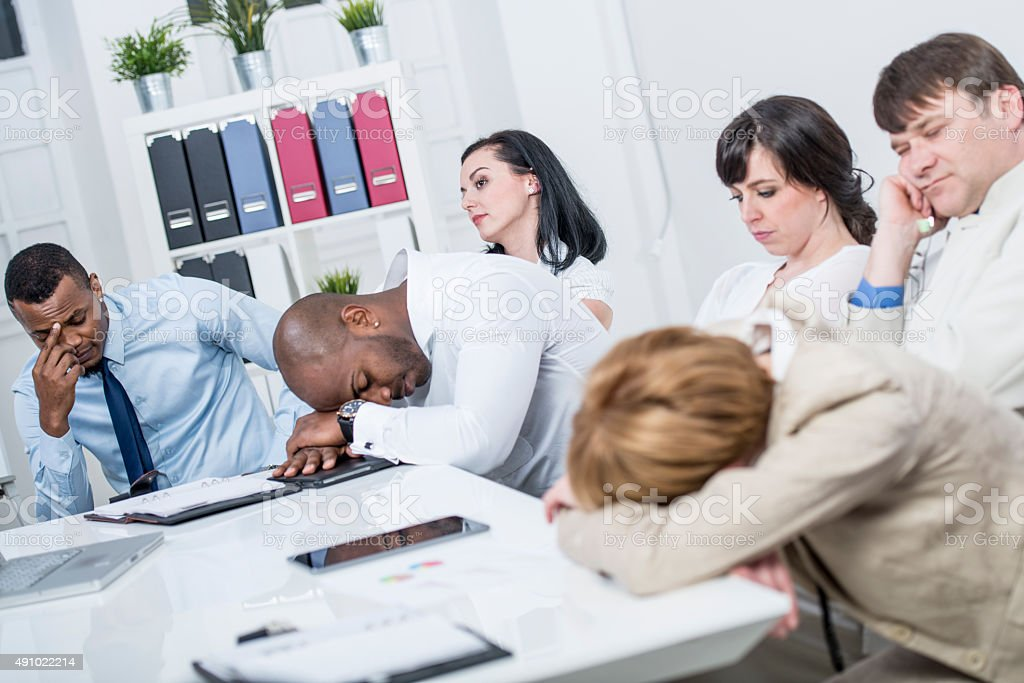Sleeping at Business Meeting stock photo