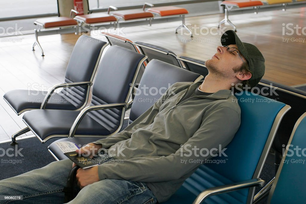 Sleeping at the airport royalty-free stock photo