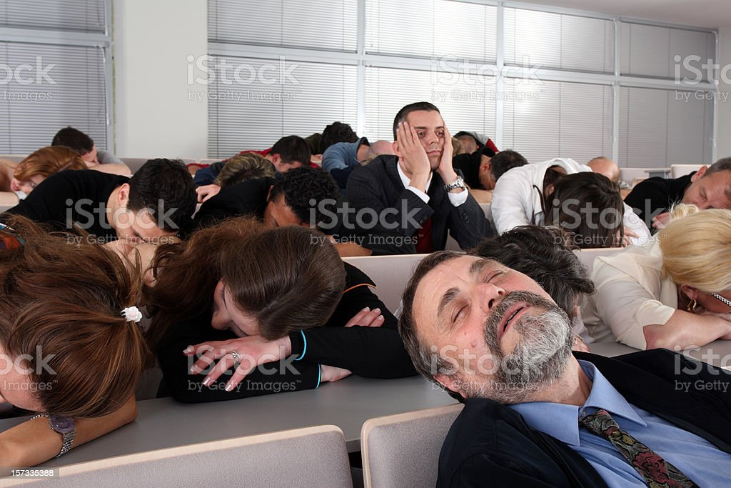 Sleeping audience at a boring business seminar stock photo