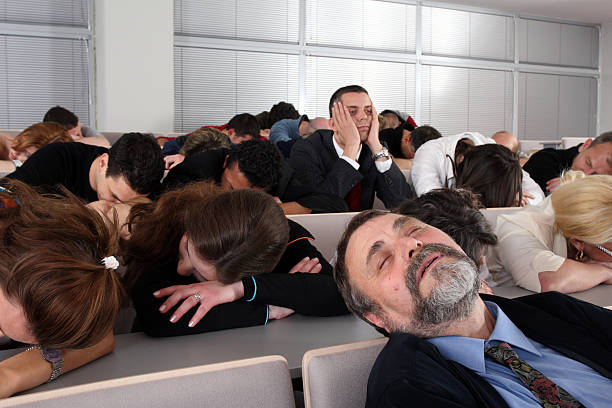 Sleeping audience at a boring business seminar foto