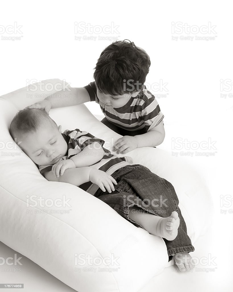 Sleeping Baby Boy With Big Brother royalty-free stock photo