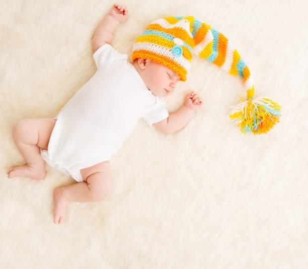 Sleeping Baby, Newborn Kid Sleep In Hat, New Born Infant Child stock photo