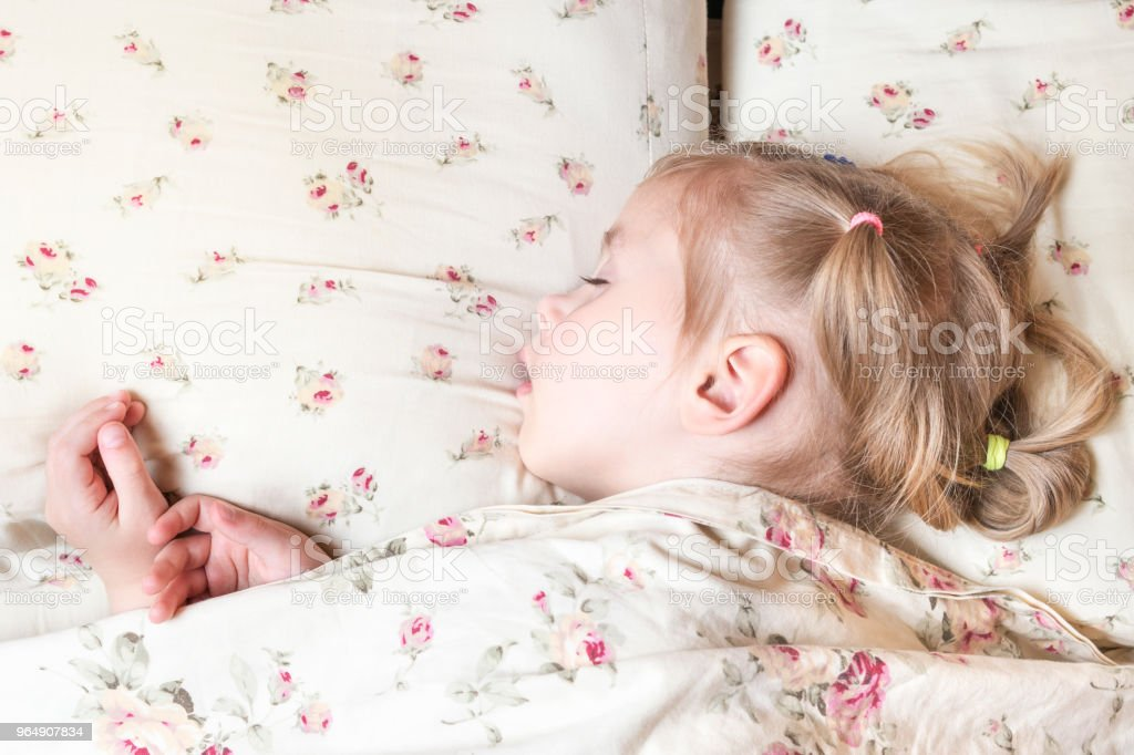 Sleeping baby under the blanket royalty-free stock photo