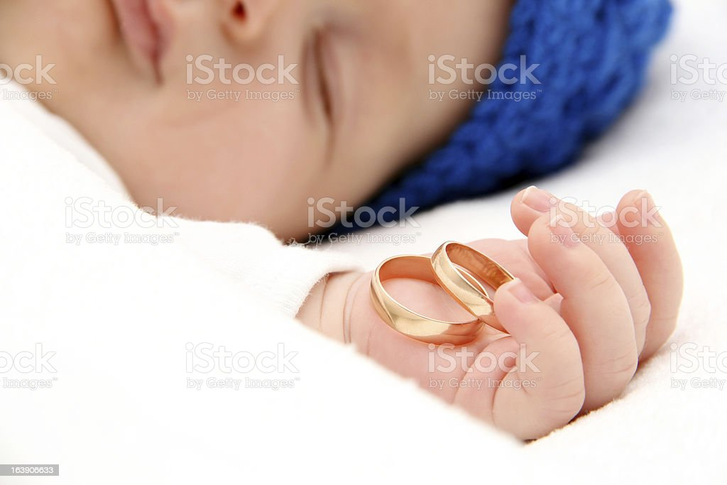 Sleeping baby with wedding rings royalty-free stock photo