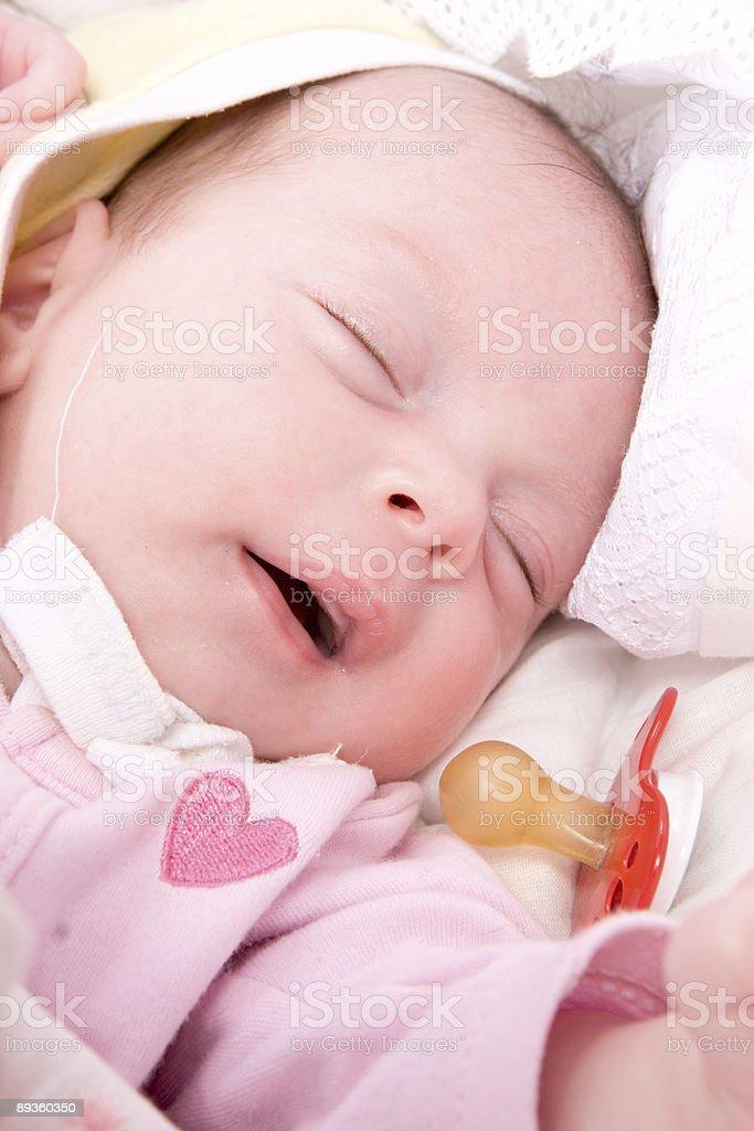 Sleeping babygirl royalty free stockfoto