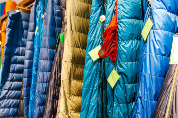 sleeping bags for sale at a sports equipment store stock photo