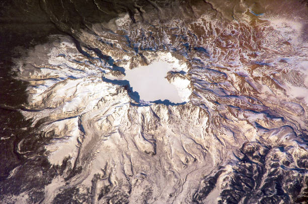 sleeping baitoushan volcano in winter, satellite view. 4.5 kilometer diameter 850 meters deep summit caldera of the volcano filled with waters of lake tianchi. elements of this image furnished by nasa - diameter stock pictures, royalty-free photos & images