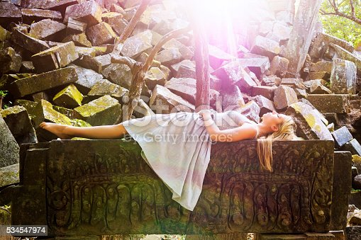 891402486 istock photo Sleeping Beauty Fairytale Princess Laying on Rock Bed 534547974