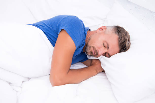 Sleeping beauty. Man handsome guy lay in bed. Get enough amount of sleep every night. Tips sleeping better. Bearded man sleeping face relaxing on pillow. Pleasant relaxation concept. Perfect rest stock photo
