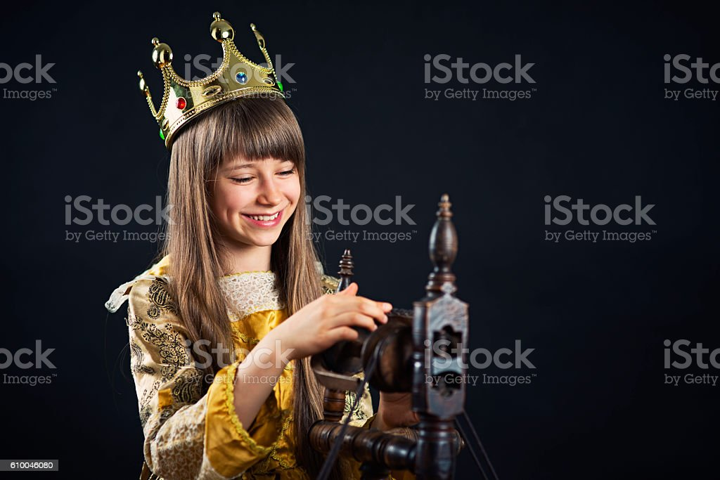 Sleeping Beauty princess playing with spindle stock photo