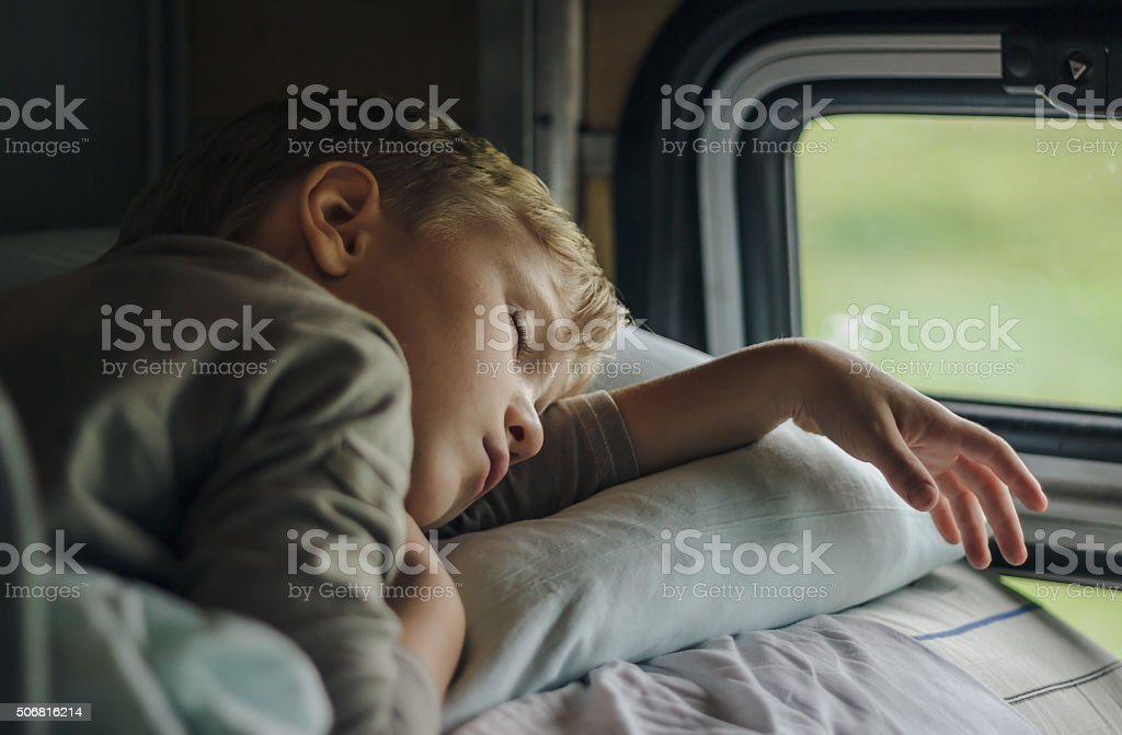 Sleeping boy in front of window royalty-free stock photo