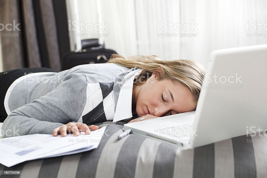 Sleeping Business Traveler Tired, Exhausted, Napping Working in Hotel Room royalty-free stock photo