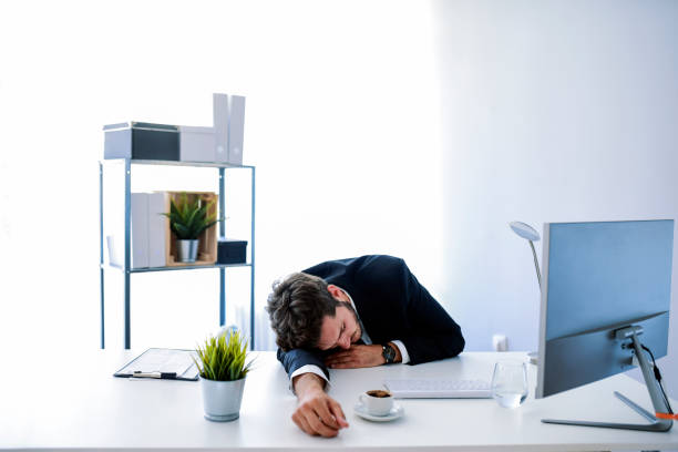sleeping businessman - man face down stock pictures, royalty-free photos & images