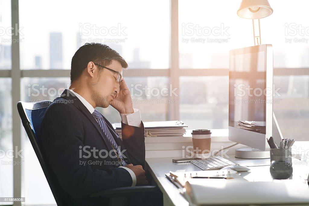 Sleeping businessman stock photo
