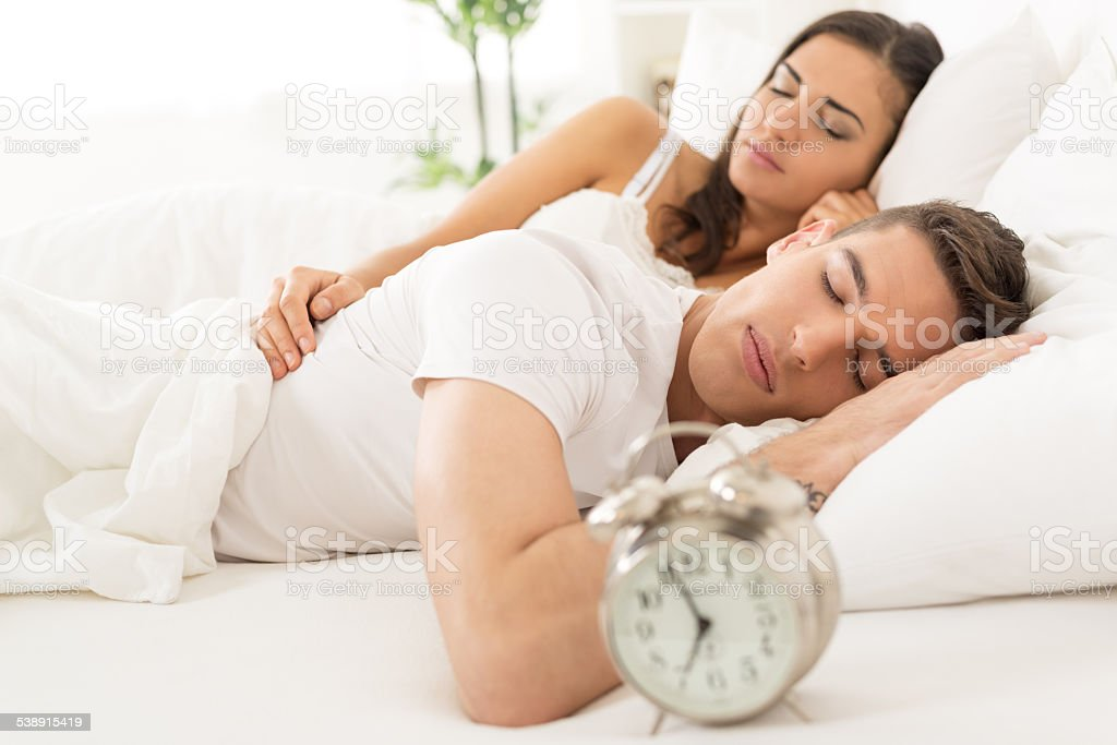 Sleeping Couple In Bed stock photo